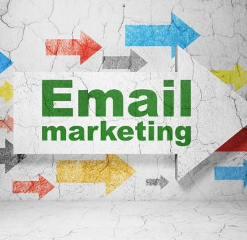 Finance concept: arrow with Email Marketing on grunge wall backg